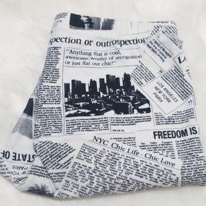 Newspaper print leggings, small